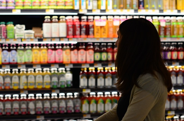 Women walking by shelves of healthy drinks in the grocery store